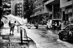 Shan Mei St is blocked 2_FOT6916 (camera2m) Tags: road street people blackandwhite bw hk water monochrome hongkong nikon sw schwarzweiss hkg fotan