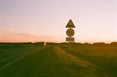 hitch-hiking (Maxim Nill) Tags: road trip travel sunset film nature analog 35mm landscape photography nikon view roadtrip scene hitchhiking analogue fg20 filmphotography   photographersontumblr