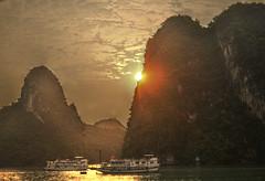 Sunrise over Halong Bay (idreamlikecrazy) Tags: cruise sea sun sunrise bay nikon ship cliffs hills limestone hdr halong limestonecliffs d5000 nikond5000