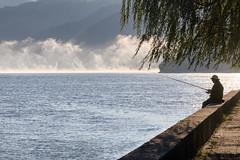 Fishing (Irene Becker) Tags: morning blue silhouette fog sunrise river landscape fishing serbia tourist alas gorge danube balkan srbija dunav irongates magla délvidék donjimilanovac djerdap đerdapskaklisura djerdapnationalpark djerdapgorge pecaros imagesofserbia bordistrict porečkizaliv northeasternserbia