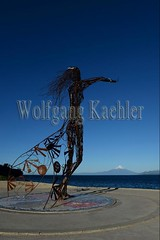 60072240 (wolfgangkaehler) Tags: 2016 southamerica southamerican latinamerica chile chilean southernchile town puertovaraschile view lakellanquihue lakedistrict osornovolcano lake mountain volcano waterfront art publicart sculpture sculptures metalart metalartwork metalsculpture metalsculptures woman