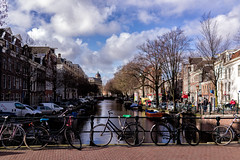 Sunny Day in Amsterdam (anton.treskunov) Tags: sonyrx1 flickr urban netherlands bridge 2016 sky chanel 500px city rx1 boats bycicles amsterdam clouds
