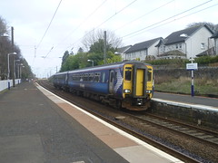Stopping train for Glasgow Central arrives at Kirknewton, West Lothian. (calderwoodroy) Tags: 156514 class156dmu dmu dieselmultipleunit shottsline scotrail cr caledonianrailway westlothian eastcalder midcalder kirknewtonstation railwaystation station kirknewton