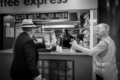 Not me, him! (Salle-Ann) Tags: street urban bw men hat photography blackwhite express pointing bondijunction trainstationcoffee
