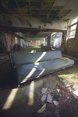 Resort couch (Bryan Rusch) Tags: abandoned moss decay resort lobby couch