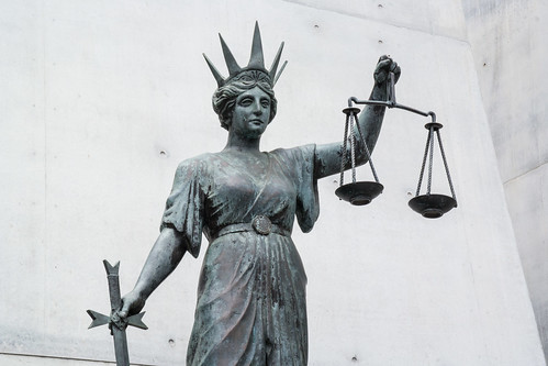 The Greek goddess Themis, .personification of divine order, fairness, law, natural law, and custom..