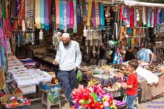 Seller Man 2 (`ARroWCoLT) Tags: pink people orange man metal shop turkey shopping toy toys colorful child türkiye istanbul goods earphone cloth seller satıcı