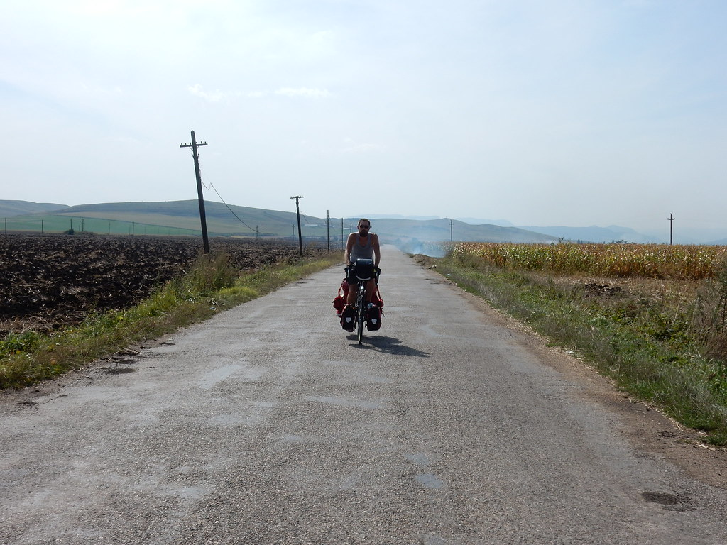 Andre cycling through burning fields