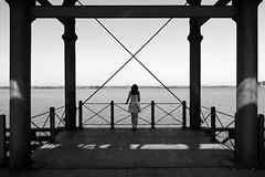 (cherco) Tags: bridge light sea sky blackandwhite woman girl skyline composition canon puente liberty libertad mar mujer alone shadows legs horizon columns x human cielo lonely xxx railing melancholy horizonte melancolia barandilla composicion columnas solitaria 60d