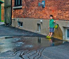 Sprinkler Boy   -  Ottawa 06 14 (Mikey G Ottawa) Tags: street city boy people ontario canada water child ottawa sprinkler precious resource commodity freshwater drinkingwater potable mikeygottawa