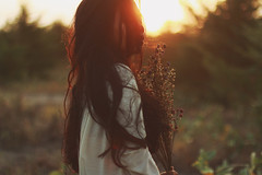 I like to embrace the misery (Januarain Photography) Tags: flowers light sunset summer portrait people orange woman sun flower nature girl beauty lady female person photography photo soft pretty outdoor sunny photograph lovely simple