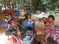 Kids selling postcards, books and maps at the back entrance of Angkor Wat, Siem Reap Cambodia (rodeochiangmai) Tags: kids cambodia angkorwat