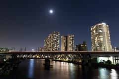 Tokyo Monorail and Shibaura Konan (Masahiko Futami) Tags: reflection japan architecture night canon tokyo cityscape photographer  moonlight  minatoku      seabreeze tokyobayarea    sibaura eos5dmarkiii citytraveler