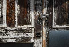 Reinforced (hutchphotography2020) Tags: door abstract nikon rust weathered latch masterlock peeledpaint metalplate