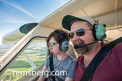 Father and daughter flying light plane over the eastern shore of Maryland, USA (Remsberg Photos) Tags: travel sky usa airplane freedom fly view maryland cockpit fields passenger awe overlooking pilot easton hover trres
