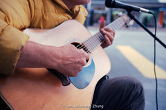 Playing guitar (xiaomao zhang) Tags: street camera leica light newzealand portrait people music color 35mm lens photography photo newspaper artist guitar f14 candid streetphotography streetportrait auckland negative scanned epson streetphoto 135 newzeland 135mm 114 streetmusician ektar candidphotography c41 streetphotographer c41process xiaomao negativefilm leicamp 135film leicaphotography summliux streetphotgrapher leicaphotographer xiaomaozhang