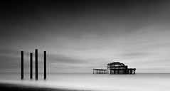 West Pier and Posts (Richard Reader (luciferscage)) Tags: fujixt2 fujifilmxt2 brighton pier posts bnw blackandwhite blackandwhitephotography longexposure monochrome mono seascape clouds englishchannel bw