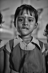 The Tough Nut (alisdair jones) Tags: ef35mmf14lusm portrait child girl preschool uniform nainativu sri lanka