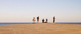 Anglers at the horizon.