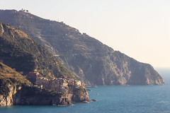 Distant Manarola (NykO18) Tags: ocean sea italy plants building water forest woods flora europe liguria manmade housing cinqueterre liguriansea mediterraneansea corniglia laspezia parconazionaledellecinqueterre naturalelement