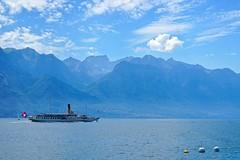 Bateau typique Suisse (mattkayphotography) Tags: sky mountain lake switzerland boat eau suisse swiss transport lac ciel nuages bateau drapeau montagnes classique typique patriote bateauvapeur