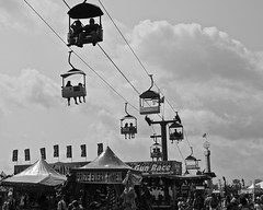 Fun & Games (tim.perdue) Tags: carnival columbus ohio summer sky bw white black game water monochrome clouds race fun fairgrounds gun state time fair games center every exposition prize chance glider midway skyride skill 2014
