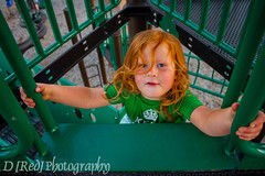 Peek (D [Red] Photography) Tags: park wood red summer portrait blackandwhite orange canada flower color cute green nature monochrome playground yellow metal kids children fun photography kid funny edmonton play outdoor candid august redhead alberta amateur highlight dred 2014 yeg dhread
