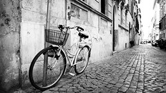 Cobblestones (Playing_with_light) Tags: bw italy rome roma bicycle wall nikon basket wheels transport cobblestones d800