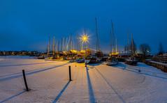 A harbour in Helsinki (Antti Tassberg) Tags: meri 15mm varjo yö fisheye jää talvi hdr vene longexposure satama lauttasaari boat dark harbour helsinki ice laru lowlight marina night nightscape port prime sea shadow winter