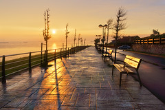 benches on park at sunset near sea (Mimadeo) Tags: ocean park sunset sea sky cliff reflection beautiful clouds bench relax landscape evening wooden spain chair colorful peace view chairs dusk vibrant seat vivid peaceful calm sit rest benches recliner idyllic tranquil getxo