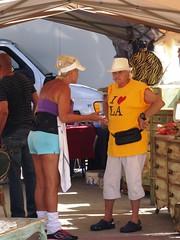 The haggler in yellow - LA's Melrose & Fairfax Flea Market (ashabot) Tags: people la losangeles markets cities streetlife streetscenes peoplewatching fleamarkets marketscenes