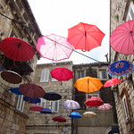 "Umbrellas in Korčula Old Town <a style=""margin-left:10px; font-size:0.8em;"" href=""http://www.flickr.com/photos/14315427@N00/14645977640/"" target=""_blank"">@flickr</a>"