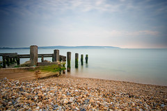 (Claire Hutton) Tags: uk longexposure blue sea england seascape green beach nature water lens outdoors prime coast seaside sticks britain stones smooth wideangle pebbles hampshire calm coastal le edge gb daytime posts groyne keyhaven ndfilter hurstcastle 10stop nd110 10stopper sonynex5r samyang12mmf20