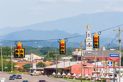 The Great Smokies. (moony: stupidly dreamy) Tags: blue summer mountains color church lights cityscape traffic tennessee clocktower layers pigeonforge signal smokies smokymountains ridges ridgelines