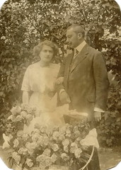 Just married? (elinor04 thanks for 27,000,000+ views!) Tags: old flowers trees roses summer portrait woman man vintage garden outdoors photo engagement backyard couple basket married dress or young age foundphoto 1900s foundphotos foundphotographs bygone rppc bygoneage elinorsvintagephotocollection