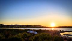 Meditating (Kacper Gunia) Tags: ocean blue sunset sea summer sun man beach yellow zeiss 35mm canon landscape sand greece meditating meditation corfu 6d distagon352ze peloponnisosdytikielladakeio peloponnisosdytikielladakeionio