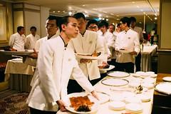 Wedding Banquet (Ding Yuin Shan) Tags: wedding hongkong pig streetphotography roast banquet melancholy tsimshatsui servers waiters