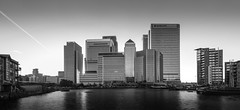 Canary Wharf Panorama (+ReEzY+) Tags: uk england panorama white black london dogs thames architecture canon river skyscape eos mono holidays place capital o2 business wharf docklands canary canarywharf riverthames isle dockyard isleofdogs greaterlondon 60d londonbusiness londonskyscapes