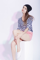 Youth fashion Concepts and Ideas. Seriuos and Calm Caucasian Slim Brunette in Hat Posing On White Box in Studion Against White. (DmitryMorgan) Tags: 1 2025years adult attractive beauty brunette caucasian clothing colorfullight confident cool elegant expressing fashionable female friendly girl glamour gorgeous happy hat lean modern mood onwhite one posing positive positivity pretty sensual sexy shorts single slim streetfashion striped studioshot stylish thin trendy twenties woman youthlifestyle