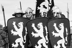 """""""I Have To Push The Pram A Lot!"""" (redfibres) Tags: bw castle wall canon eos blackwhite crest knights lincoln sword axe shield reenactment lionrampant battlements ef70200mmf4lisusm 1000d kniggits battleoflincoln"""