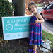 Izabel let us know that she loves reading, and is very proud of her Library Champion sign!   Become a Library Champion! Show how much you love and support your Library this summer!   Children who read a certain number of books with our TD Summer Reading Club get a 'A Library Champion Lives Here' sign!   Want your own sign? Find out more at our website! www.clarington-library.on.ca/src