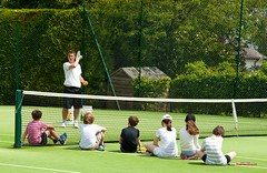 Ben on court giving juniors a lesson