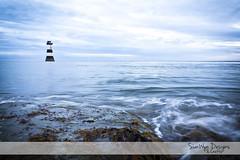 Trwyn Du Lighthouse, Penmon (Sian Wyn Design & Crafts) Tags: sunset sea sun lighthouse man beach wales point landscape island scenery north cymru du sir mor haul fon tirwedd anglesey traeth cerrig golygfa pepples ynys penmon gogledd machlyd goleudy trwyn