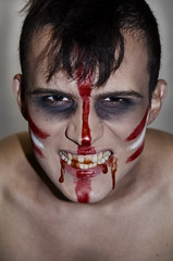 Madman Indian - zombies (Igor Kireev) Tags: red portrait white black men halloween face blood punk head zombie young makeup mohawk violence tear staring wound bizarre ghoul mental