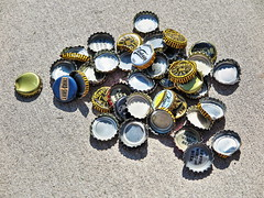 Beer Caps and Shadows on a Hard Surfice (Robert Cowlishaw (Mertonian)) Tags: 2 beer yellow canon silver concrete bottle shadows mark caps cement surface powershot canvas ii mertonian g1x robertcowlishaw canonpowershotg1xmark2 beercapsandshadowsonahardsurface monkofthewestdesertcom