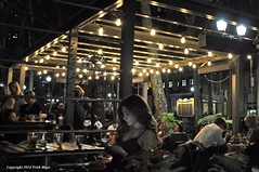 Texting To The Music Of The Night (Trish Mayo) Tags: woman night restaurant bryantpark thebestofday gnneniyisi