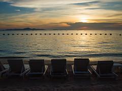 Watching Sunset over Pattaya beach (Atibordee_K) Tags: ocean trip sunset sea people beach nature beautiful beauty sign sunrise season thailand chair asia honeymoon gulf enjoy spa attraction pattaya