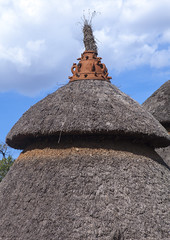 Konso Tribe Traditional Houses With Pots On The Top, Konso, Omo Valley, Ethiopia (Eric Lafforgue) Tags: poverty africa house vertical outdoors photography community day village nobody nopeople tribal unesco worldheritagesite hut homemade simplicity omovalley homestead tradition ethiopia tribe cultures domesticlife anthropology developingcountries lifestyles hornofafrica eastafrica thiopien etiopia ethiopie etiopa ruralscene colorpicture nonurbanscene  konso etiopija colourimage ethiopi indigenousculture  africanculture etiopien etipia  etiyopya  builtstructure residentialstructure colourpicture         ethio1404260