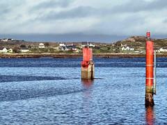 Aran Islands 1 (saxonfenken) Tags: ireland houses red sea two galway harbour posts 6928 pregamewinner 6928land