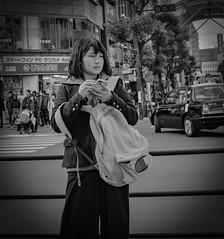 Cute phone case (Bill Morgan) Tags: fujifilm fuji x100f kichijoji tokyo street girl bw jpeg